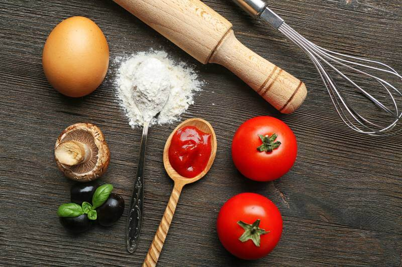 Flour with tomato paste and pasta ingredients