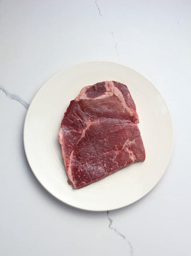London broil meat cut with crisscross pattern