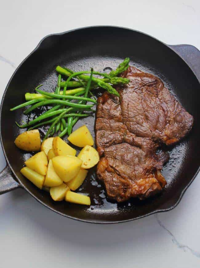 Medium-rare London broil with vegetables