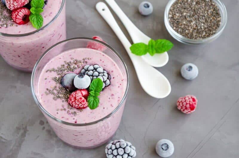 glasses of smoothie with frozen berries