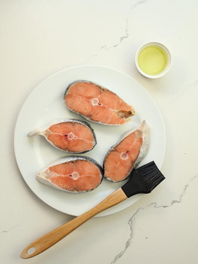 salmon with oil and brush