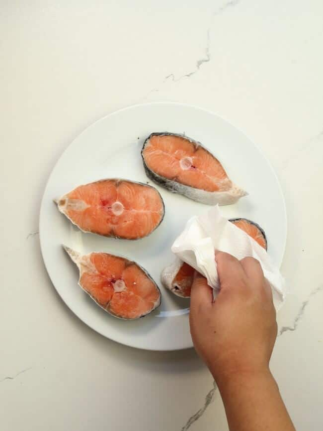 pat dry salmon with paper towel