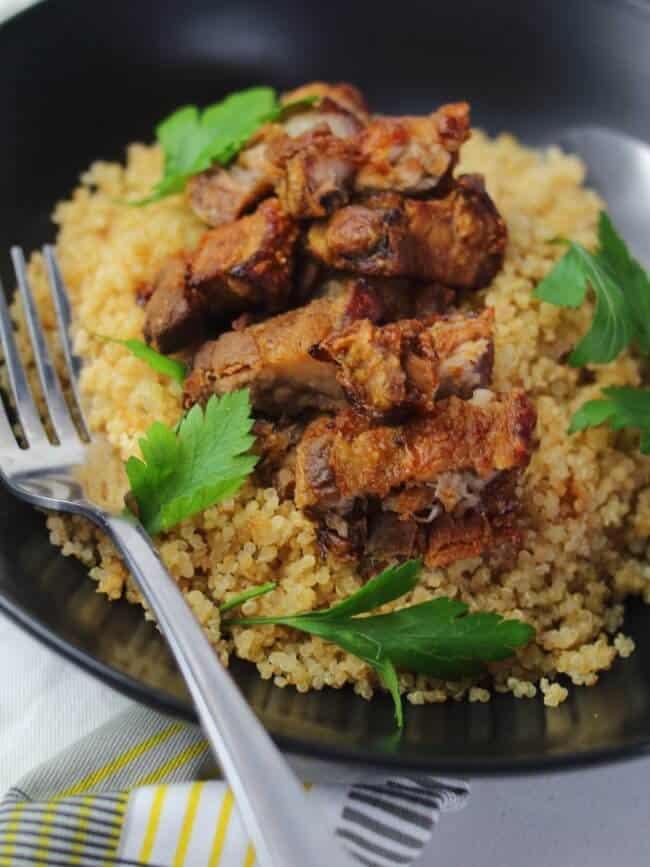 crispy pork belly slices on rice