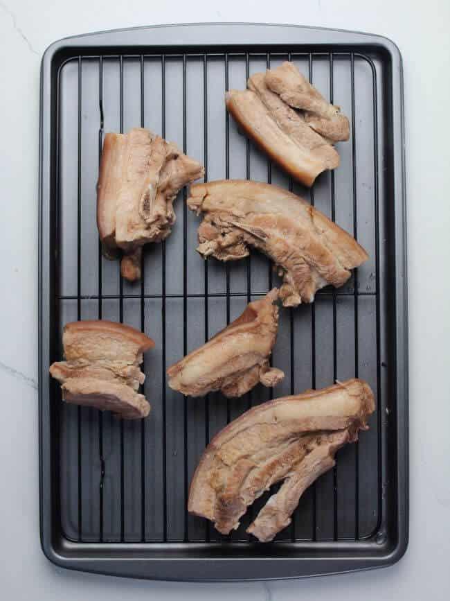 pork belly on a cooling rack
