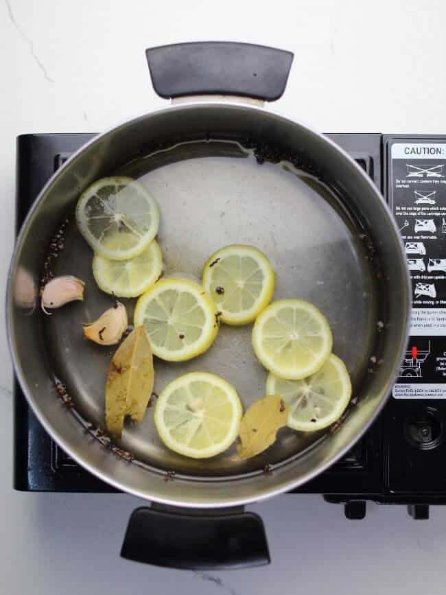 saucepan with water and herbs