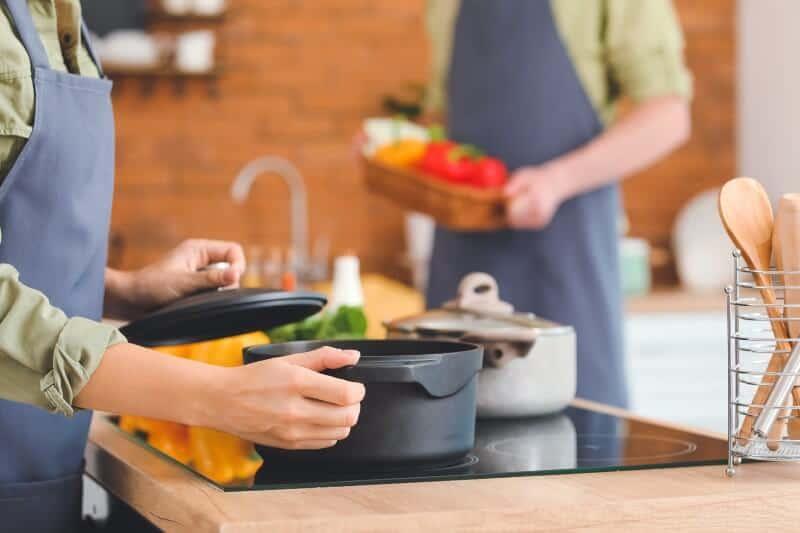 Woman holding black pot