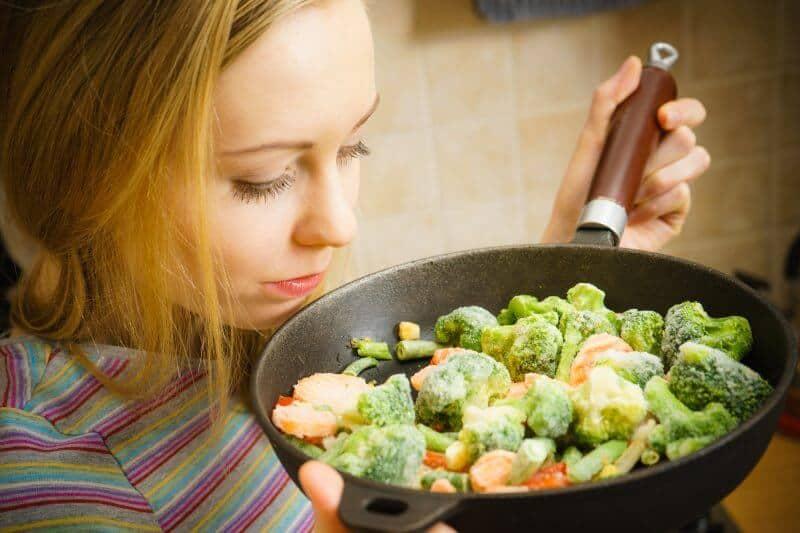 Woman Cooking On Pan