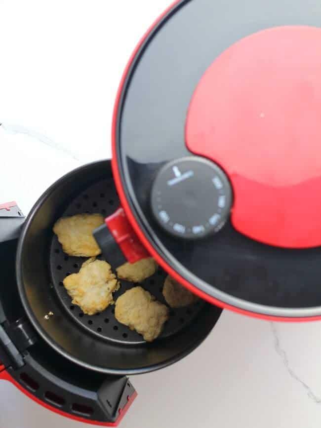 Chicken nuggets in red air fryer