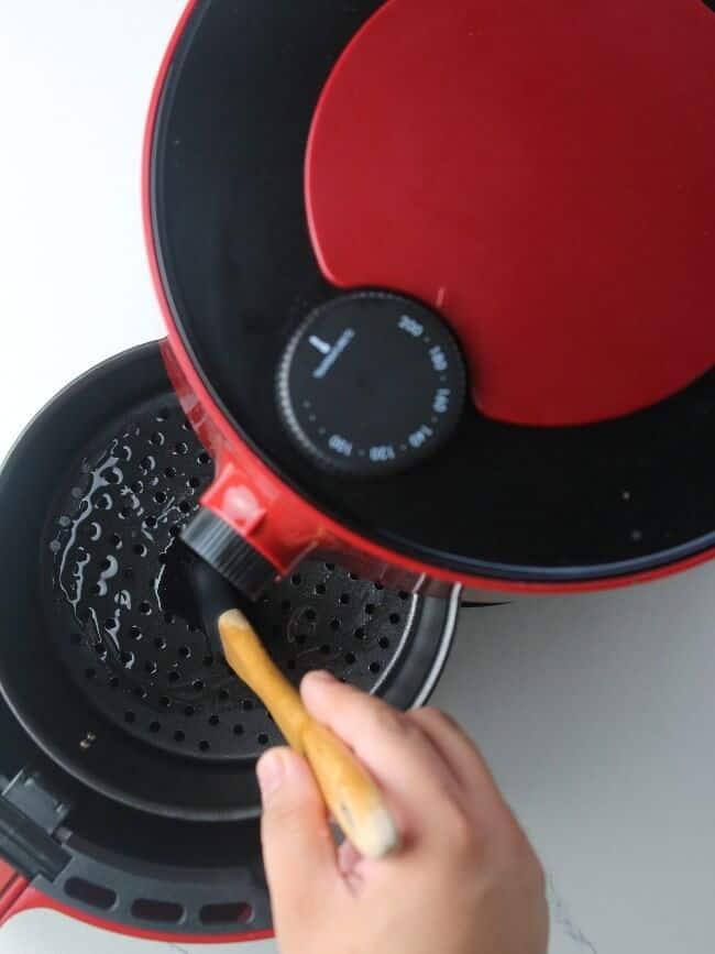 Brushing oil on air fryer