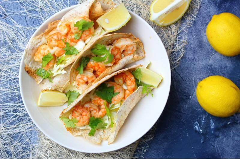 shrimp tacos with garnish