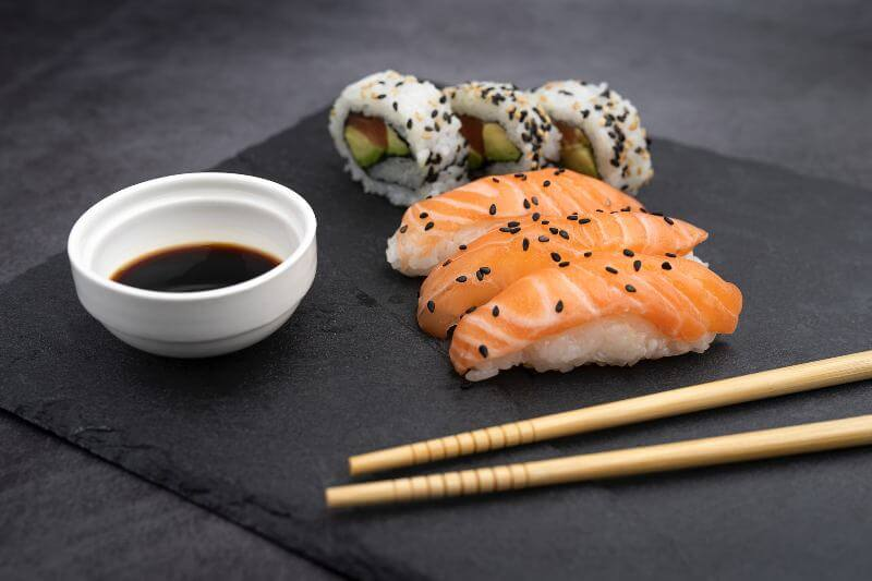 sushi with soy sauce and chopsticks