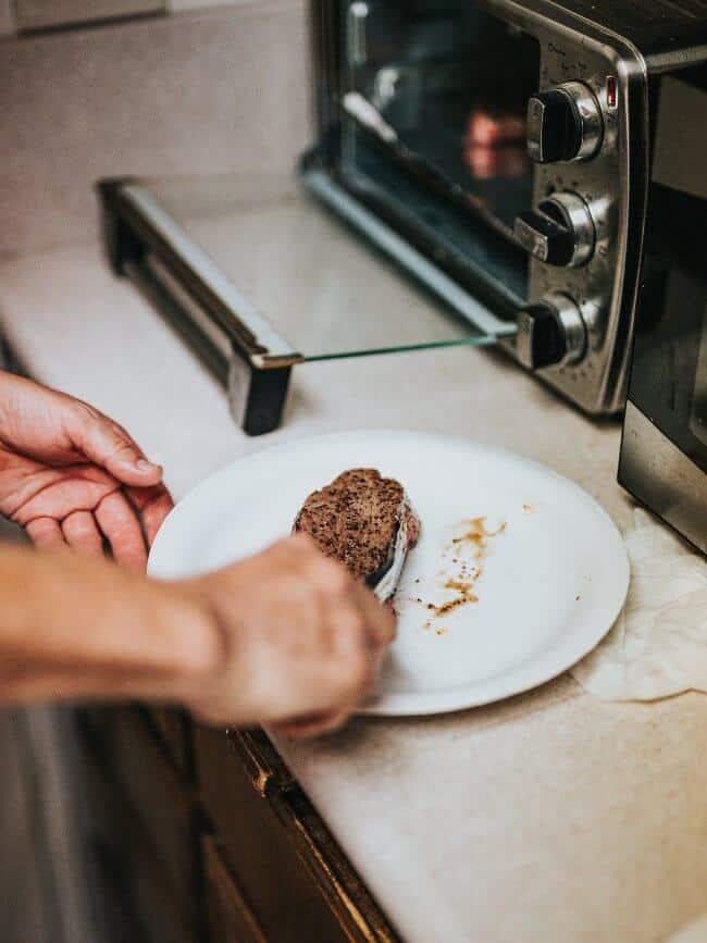 woman cooking using microwave air fryer