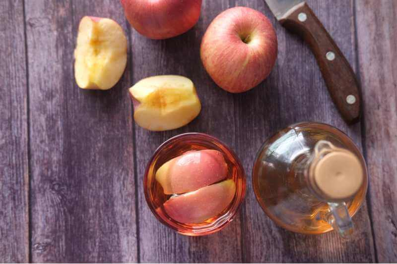 sliced apples and a bottle