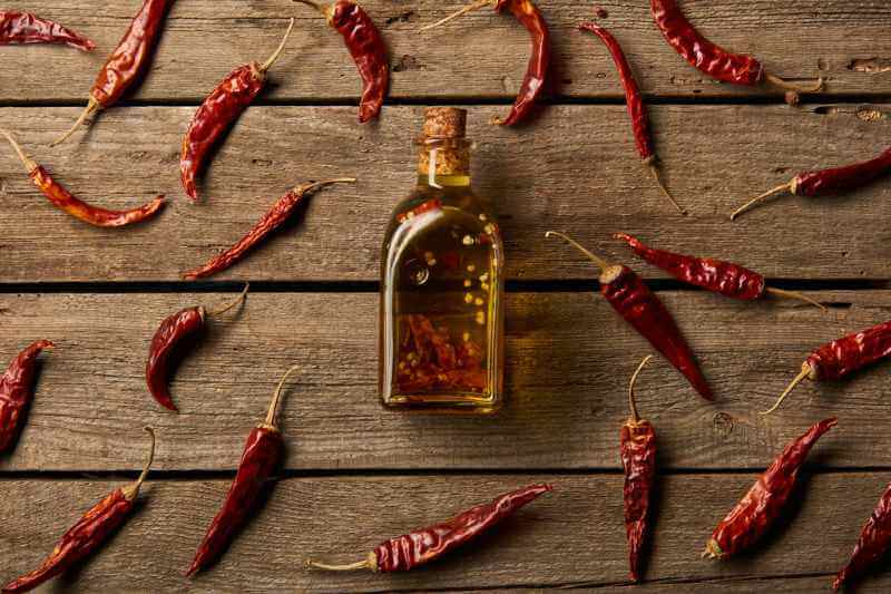chili oil in bottle with chilis