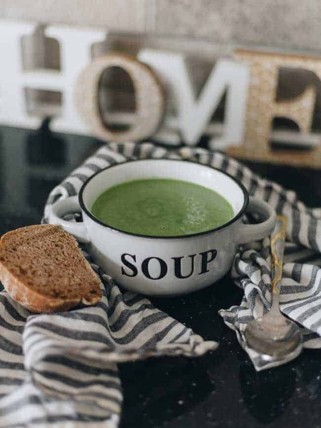 thick green soup with bread