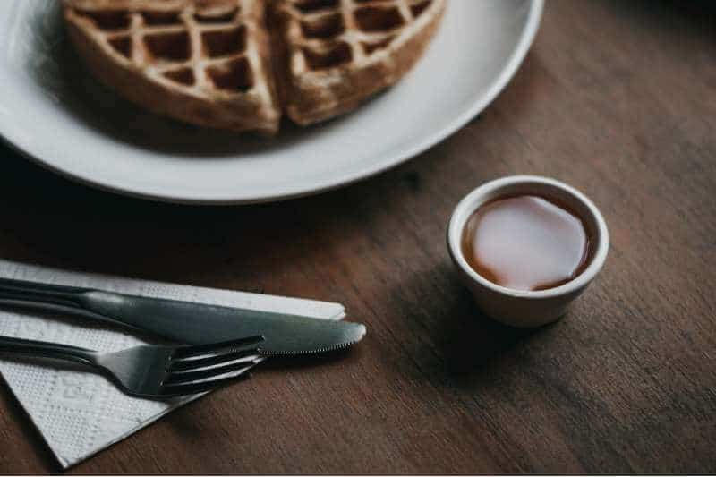 dark sweet syrup with waffles
