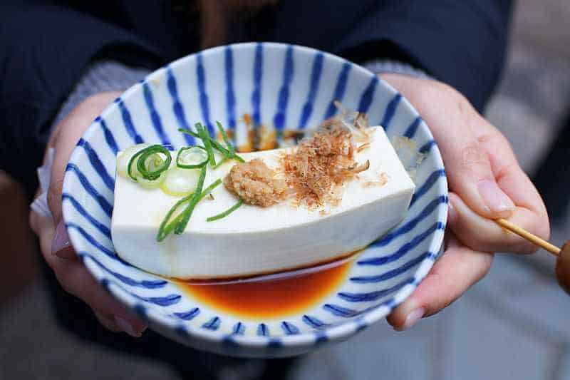 tofu in blue striped bowl