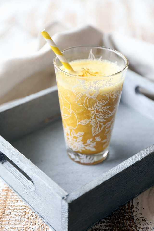 delicious mixed yellow fruits smoothie
