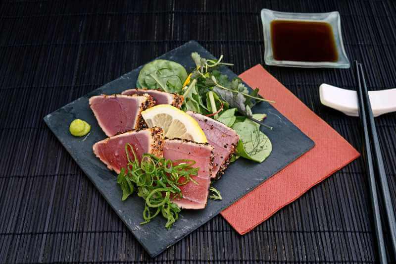 sashimi with lemon and greens