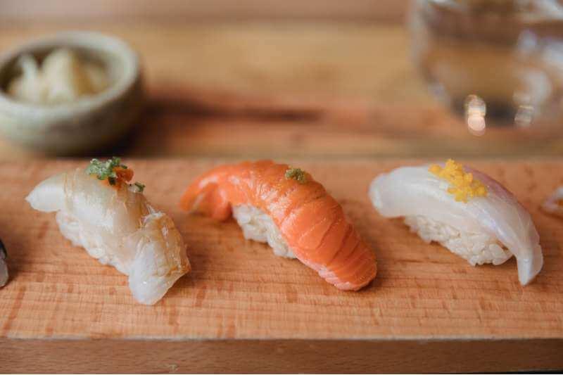 nigiri with raw fish toppings