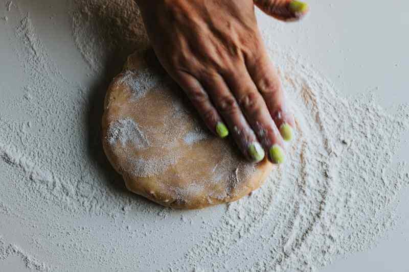 flat brown dough with flour