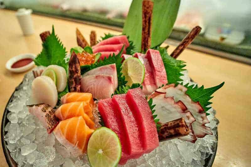 variety of sashimi served  in a bowl with ice