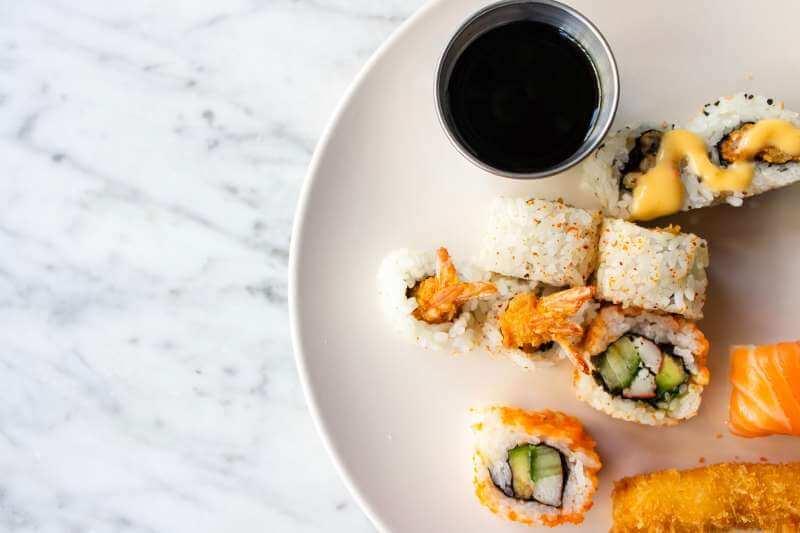 maki and nagiri on plate with soysauce